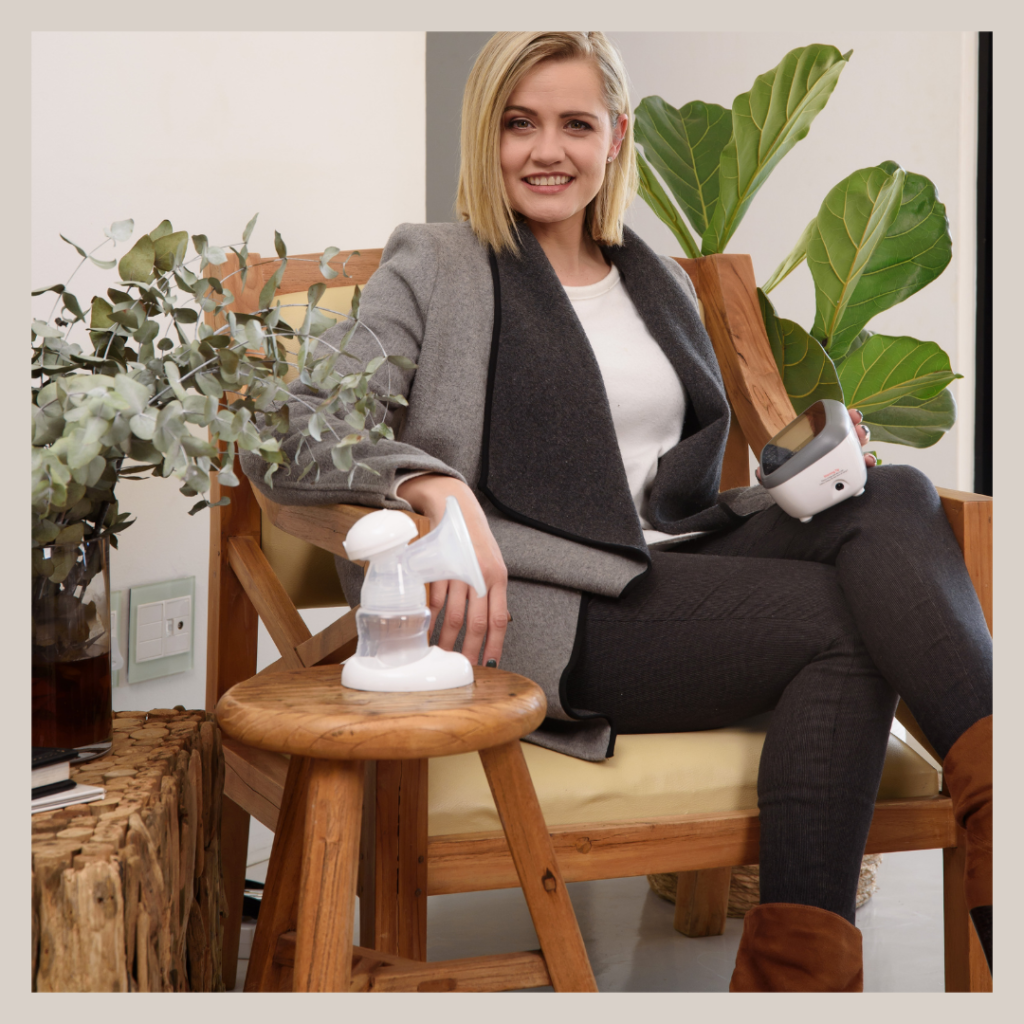 Working mom expressing breastmilk with the BabyWombWorld Double Electric Breastpump